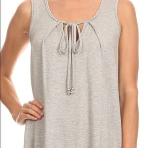 Tops - Super soft and relaxed sleeveless basic tank. NWOT